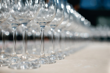 Close up picture of empty glasses on the beige tablecloth  in re
