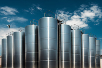 Huge stainless steel wine factory tanks shot outside at daylight
