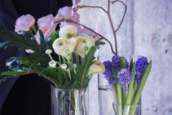 Peonies. Bouquet of peonies in a glass vase. Hyacinth.