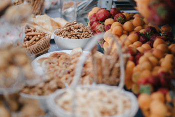 Vertical shot of wedding candy bar with nuts, fruits and pastry