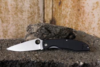 Knife on the background of the asphalt.