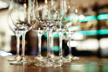 Close up picture of empty glasses on the wooden counter  in rest