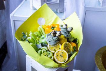 Unique bouquet of fruits and berries. Decorative bouquet of green.