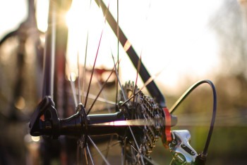 Closeup of bicycle chain shot outdoors at sunset with copy space