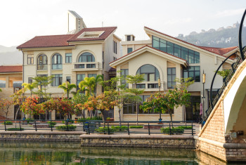 Street with beautiful villas on the bank of the canal in Shenzhe