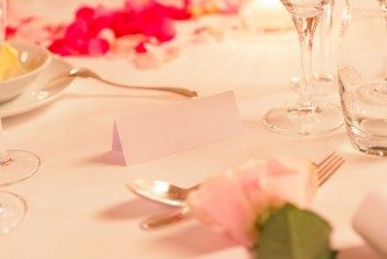 White Name Tag on Flowery Wedding Dinner Table with Silverware