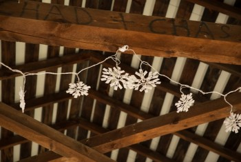 Couple Names Hand Written on Wood Beams with Fairy Lights