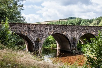 Old Medieval Bridge in Countryside on Sunny Day
